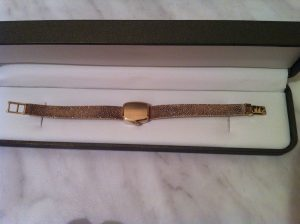 Tissot gold watch