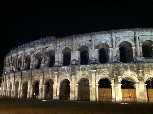 Nimes amphitheatre at night