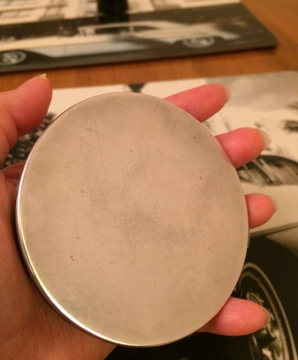 Back case silver powder compact